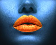 Creative colorful makeup. Bodyart, lipgloss on sexy lips, girls mouth. Orange lips on blue skin