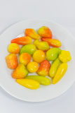Creative colorful Thai dessert, Luk Choop, on white plate. It is very sweet dessert Royalty Free Stock Photos