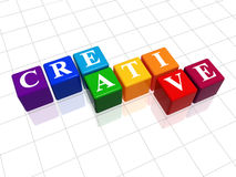 Creative in colour 2. 3d colour cubes with text - creative, word Royalty Free Stock Photography