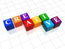 Creative in colour. 3d colour cubes with text - creative, word Royalty Free Stock Images