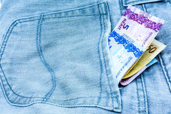 Creative composition of Brazilian Money (Reais) on the jeans Stock Photos