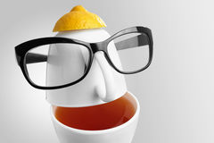 Creative composition on the theme of tea. Tea cups in the form of a human face with glasses Royalty Free Stock Image
