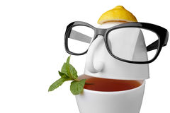 Creative composition on the theme of tea. Tea cups in the form of a human face with glasses. Isolated on white Royalty Free Stock Photos