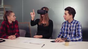 Creative computer science students in modern office wearing Vr headset and using Vr application. Futurism and innovation stock footage