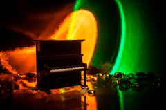 Creative concept. Artwork decoration with piano on dark toned foggy background with light. Selective focus stock image