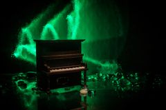 Creative concept. Artwork decoration with piano on dark toned foggy background with light. Selective focus royalty free stock photography