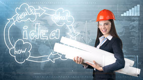 Creative concept, beauty businesswoman standing with blueprints on painted background near idea organizational chart. Royalty Free Stock Photo