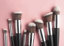 Beauty brushes. Creative concept beauty fashion photo of cosmetic product make up brushes kit on pink background stock photos