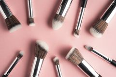 Beauty brushes. Creative concept beauty fashion photo of cosmetic product make up brushes kit on pink background royalty free stock images
