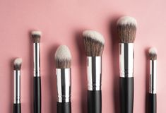 Beauty brushes. Creative concept beauty fashion photo of cosmetic product make up brushes kit on pink background royalty free stock image