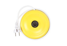 Creative concept of a bright yellow kettle support with a plug. As a fruit royalty free stock photo