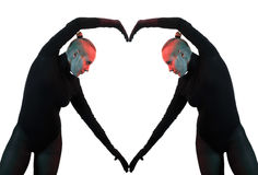 Creative concept, heart, symbol of love, fromed by two female bodies mirroring each other Royalty Free Stock Images