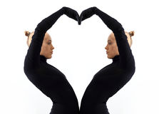 Creative concept, heart, symbol of love, fromed by two female bodies mirroring each other Stock Images