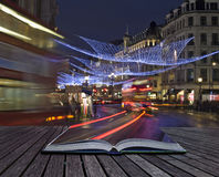 Creative concept idea of London Christmas lights. Creative concept of London Christmas lights coming out of pages in magical book Stock Photography