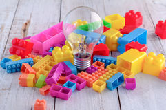 Creative concept light bulb and colorful block toy.jpg Stock Image