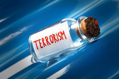 An artistic concept of a vintage bottle with a cork saying terrorism. Creative concept of a message in a bottle floating on blue waves saying terrorism Stock Image