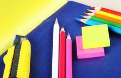 Creative concept of multicolored pencils and drawing accessories. Creative concept of multicolored pencils laying on colorful sheets of paper Royalty Free Stock Image