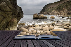 Creative concept pages of book Beautiful landscape of Porth Nanv. En beach Cornwall England Royalty Free Stock Images