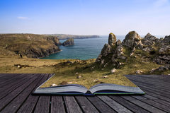 Creative concept pages of book Kynance Cove cliffs looking acros Royalty Free Stock Photo