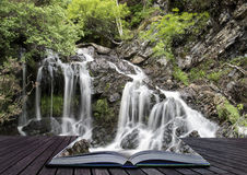 Creative concept pages of book Landscape detail of waterfall ove Stock Photos