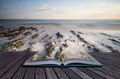Creative concept pages of book Long exposure landscape rocky sho Stock Photo