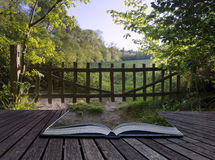 Creative concept pages of book Old countryside rustic gate into Stock Photography