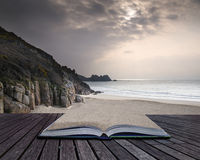 Creative concept pages of book Porthcurno yellow sand beach befo Royalty Free Stock Images