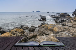 Creative concept pages of book Rocky shore and Brisons Rock in d Stock Images