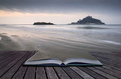 Creative concept pages of book St Michael's Mount Bay Marazion l. Andscape pre-dawn long exposure Cornwall England Stock Images