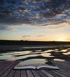 Creative concept pages of book Vibrant sunrise landscape reflect Stock Photography