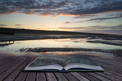 Creative concept pages of book Vibrant sunrise landscape reflect Royalty Free Stock Photography