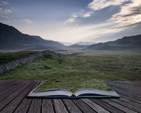 Creative concept pages of book View along misty valley towards S Stock Photo