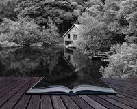 Creative Concept Pages Of Book Black And White Retro Style Picture Of Derelict Boathouse And Rowing Boats Landscape Hidden In Royalty Free Stock Photography
