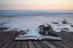 Creative Concept Pages Of Book Long Exposure Landscape Rocky Shoreline At Sunset Royalty Free Stock Photo