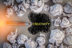 Creative concept with pencil and crumpled paper ball.jpg Royalty Free Stock Photo