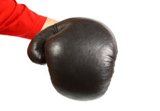 Creative concept of a boxer glove isolated on white puniching into the camera Stock Photo