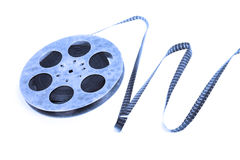 Creative concept of a retro movie film with a vintage film reel. Creative concept of a retro movie film with a vintage celluloid film reel Stock Photography