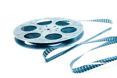 Creative concept of a retro movie film with a vintage film reel. Creative concept of a retro movie film with a vintage celluloid film reel Royalty Free Stock Photography