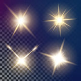 Creative concept Vector set of glow light effect stars bursts with sparkles  on black background. For Royalty Free Stock Images