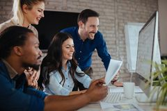 Creative coworkers working in office Royalty Free Stock Photos