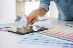 Creative creativity graphic designer working with graphics table. T,laptop and smart phone, colour chart at workplace on wooden desk , colour ideas style concept royalty free stock photography