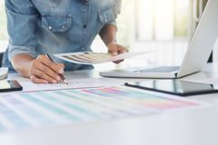 Creative creativity graphic designer working with graphics table. T,laptop and smart phone, colour chart at workplace on wooden desk , colour ideas style concept royalty free stock photos