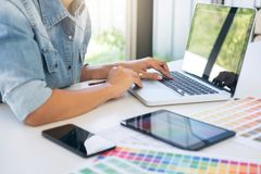 Creative creativity graphic designer working with graphics table. T,laptop and smart phone, colour chart at workplace on wooden desk , colour ideas style concept stock photography