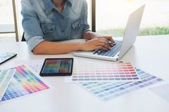 Creative creativity graphic designer working with graphics table. T,laptop and smart phone, colour chart at workplace on wooden desk, colour ideas style concept royalty free stock photography