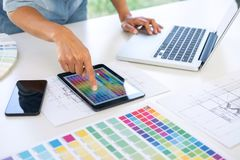Creative creativity graphic designer working with graphics table. T,laptop and smart phone, colour chart at workplace on wooden desk , colour ideas style concept stock photos