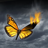 Creative Crisis. Business concept as a monarch butterfly in distress with a burning wing as a metaphor for problems in creativity and managing human sadness and royalty free illustration