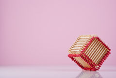 Creative Cube. Cube made of matches. Purple background Royalty Free Stock Photography