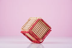 Creative Cube. Cube made of matches on purple background. Concept Stock Images