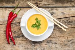 Creative cuisine. Pea Soup with chopstick on wood background Stock Photo