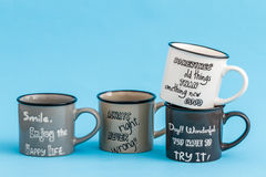 Creative, Cute Coffee Mugs on Blue Background Stock Images